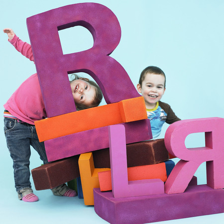 Toddlers playing with oversize letters