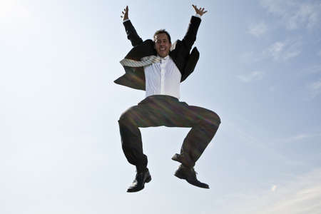 low spirited: Business man jumping