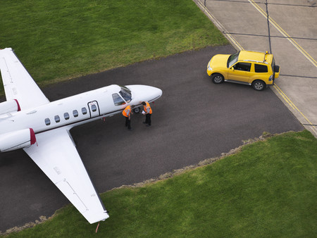 high flown: Engineers inspect jet on runway LANG_EVOIMAGES