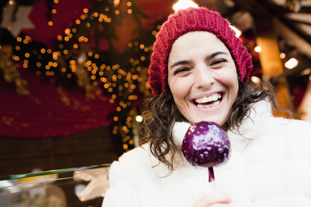 Woman holding candied apple