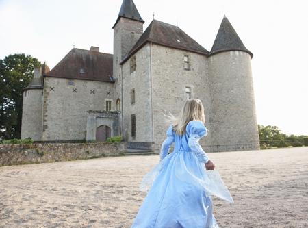 Girl as a princess infront of castle