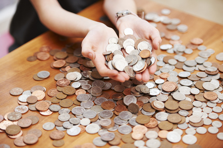 Girl holding coins in her hands