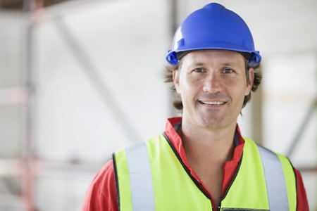 Smiling worker with hat