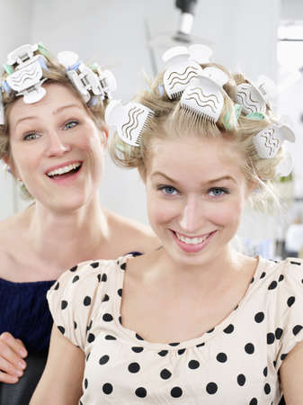 shared sharing: Women wearing rollers in salon