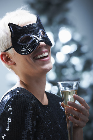 dressups: Woman wearing a cat mask LANG_EVOIMAGES