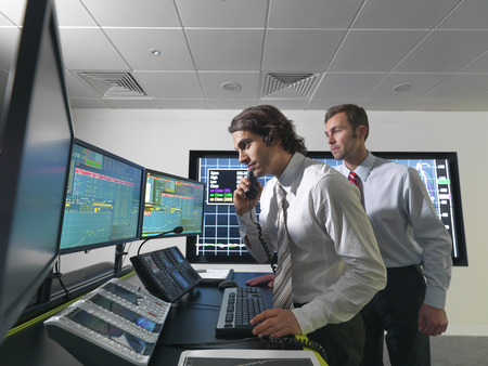 jeopardizing: Financial trader with screens