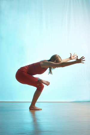 limber: Lady doing yoga in a studio