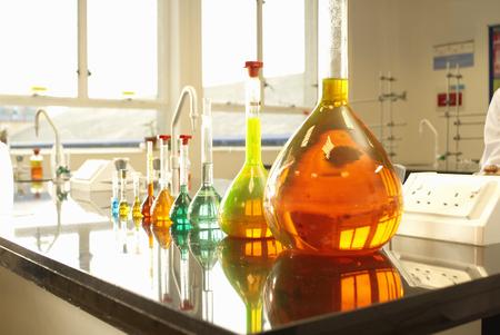 Beakers of liquid in factory