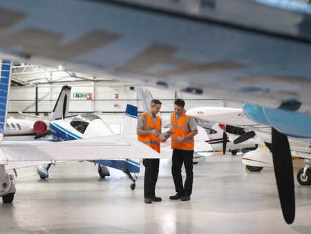 coordinating: Engineers inspect turbo-prop aircraft