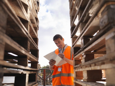 notations: Worker makes notes next to pallets