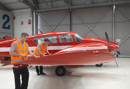 turboprop: Engineers inspect turbo-prop aircraft