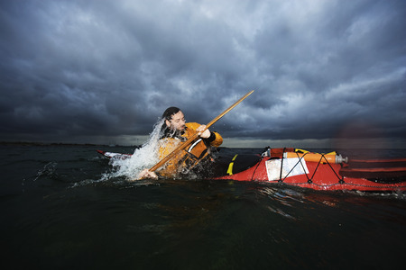 overturned overturn: Man in kayak rotating LANG_EVOIMAGES
