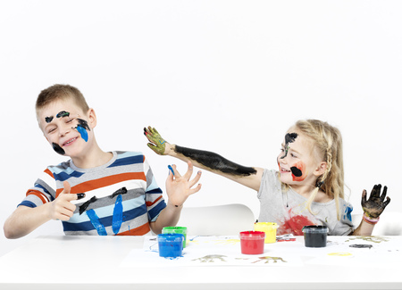 mischeif: Kids playing with finger paint