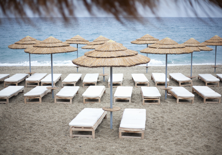 conforms: Parasols and loungers on beach LANG_EVOIMAGES