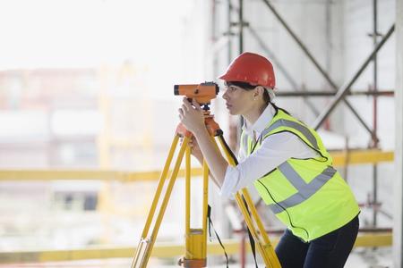 theodolite: Architect doing measuring LANG_EVOIMAGES