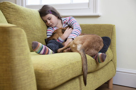 cuddled: Young girl sleeping with her dog LANG_EVOIMAGES