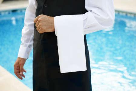 hotel staff: Hotel waiter by pool