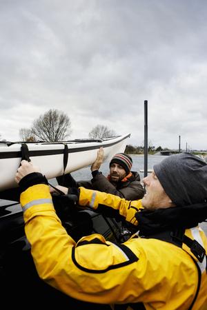 Men loading Kayak