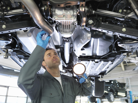 diagnoses: Mechanic working under car