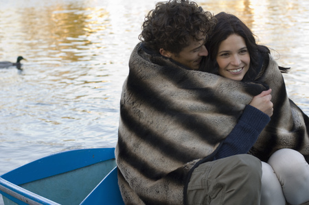 migrated: Man and woman snuggling under blanket