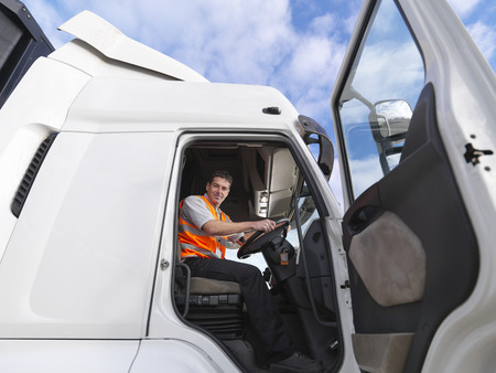 18 wheeler: Truck driver looks down from truck