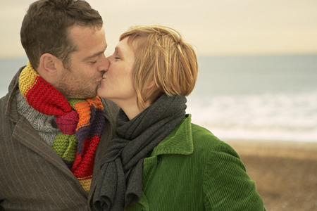 smooching: Couple Kissing on a beach Autumn Fall LANG_EVOIMAGES