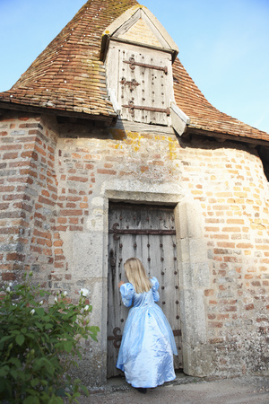 Girl as a princess,by the chapel