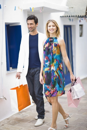purchased: Couple with shopping bags walking