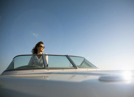 lavish: Woman on speedboat