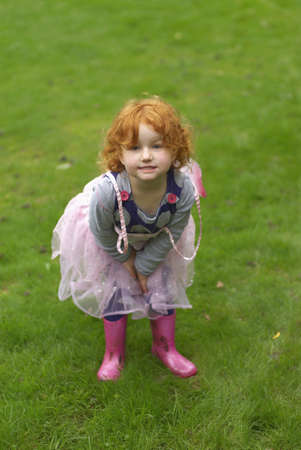 dressups: Young girl smiling in garden