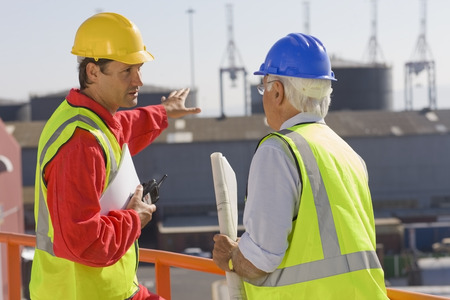 Two harbour workers talking about work