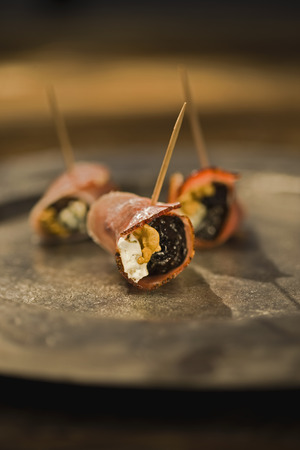 toothpick: Filled ham roll-ups LANG_EVOIMAGES