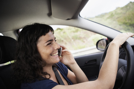 go inside: Woman using cellphone while driving