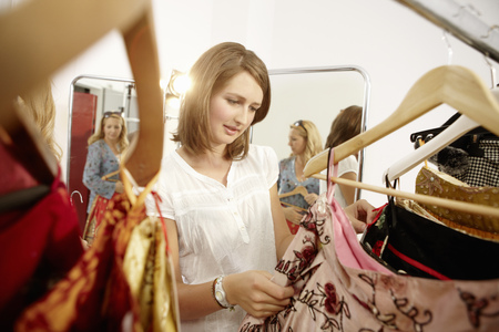 Young lady fascinated in fashion store