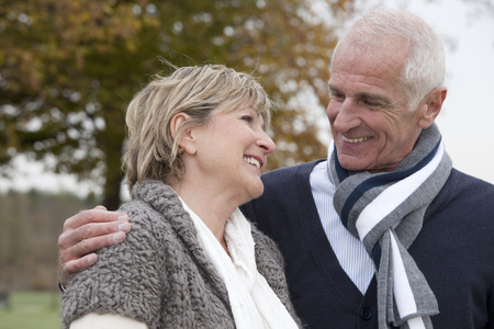 retiring: Laughing couple outdoors in autumn