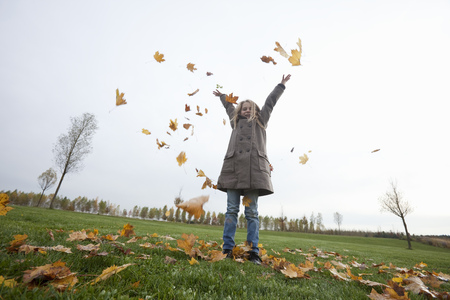 enthusiastically: Girl with autumn leaves