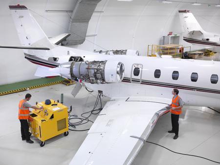 high flown: Engineers service a jet aircraft