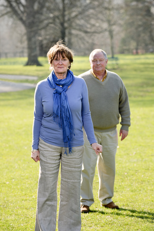 matured: Older couple walking in park