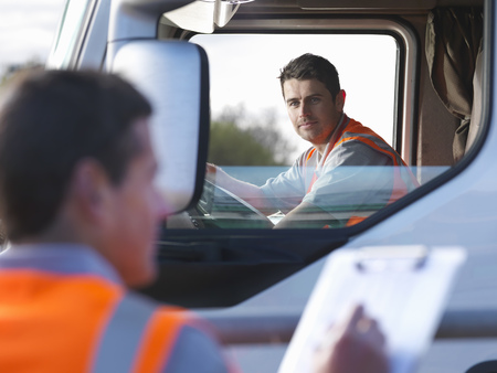 18 wheeler: Truck driver with worker taking notes