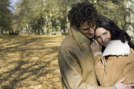 Woman snuggling against man