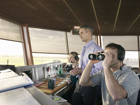 coordinating: Air traffic controllers in tower