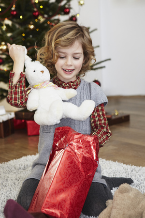 Girl putting bunny out of present