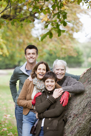 pas: Family portrait by tree in the park