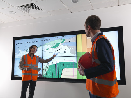 coordinating: Oil workers with geology screen