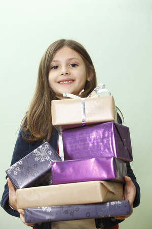 enthusiastically: portrait of young girl with presents