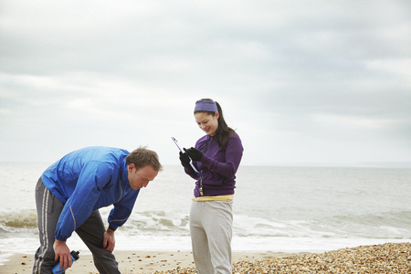 motivations: Fitness instructor with man on beach