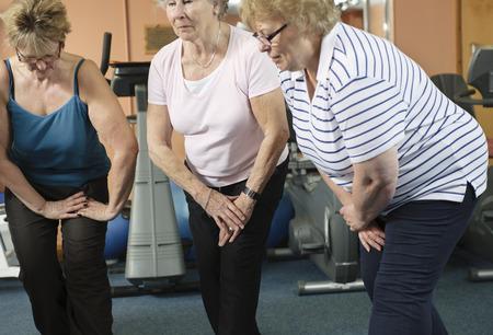 limber: Older women stretching in gym
