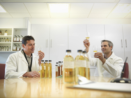 assessed: Scientists tasting whisky in plant