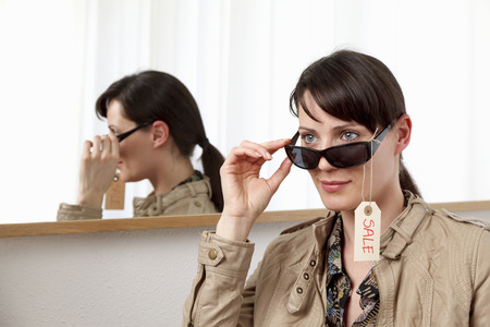 browses: Woman trying on sunglasses