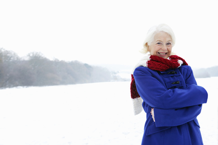 ceasing: A senior female in a snowy landscape